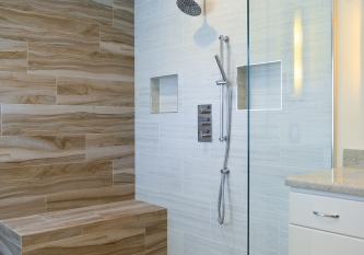 Wood-Look Tile and Frameless Glass Shower