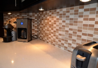 Natural Brick and Glass Backsplash