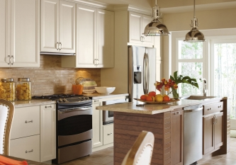omega-cabinetry-painted-maple-cabinets-in-casual-kitchen