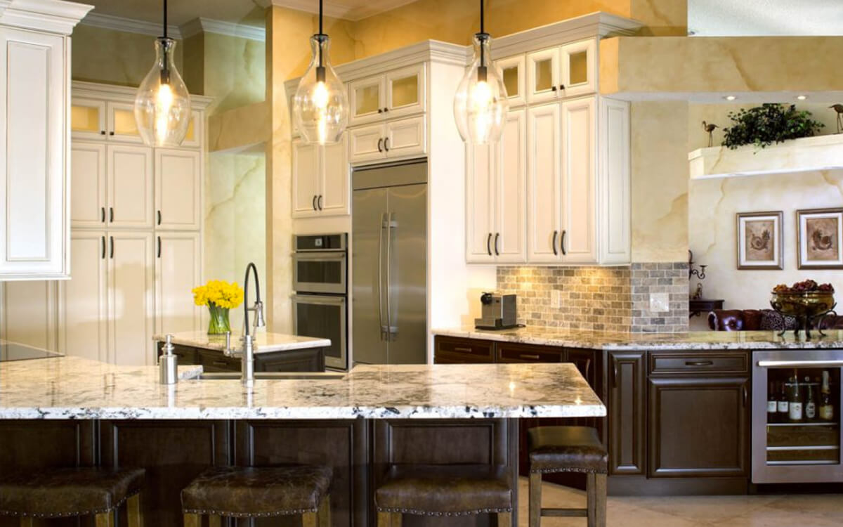 Painted wall and Stained base kitchen cabinets by Showplace Cabinetry